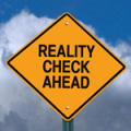 conceptual sign with words reality check ahead caution warning o