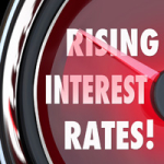 Rising Interest Rates words on a speedometer or gauge to illustrate higher costs for borrowing money in a mortgage or loan financing