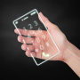 Hand holding light cell phone digital the future on dark background.